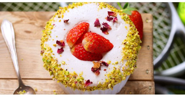 Strawberry souffle? with a crunchy pistachio topping