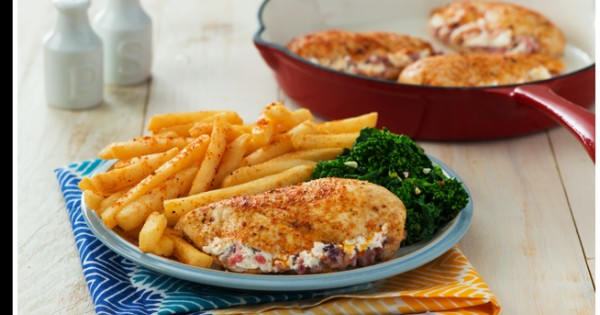 Goat Cheese Stuffed Chicken With Garlic Rapini and Superfries®