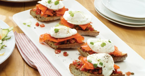 Poached egg on toast with herbed tomatoes and smoked salmon