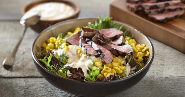 Mixed greens, corn and beef bowl